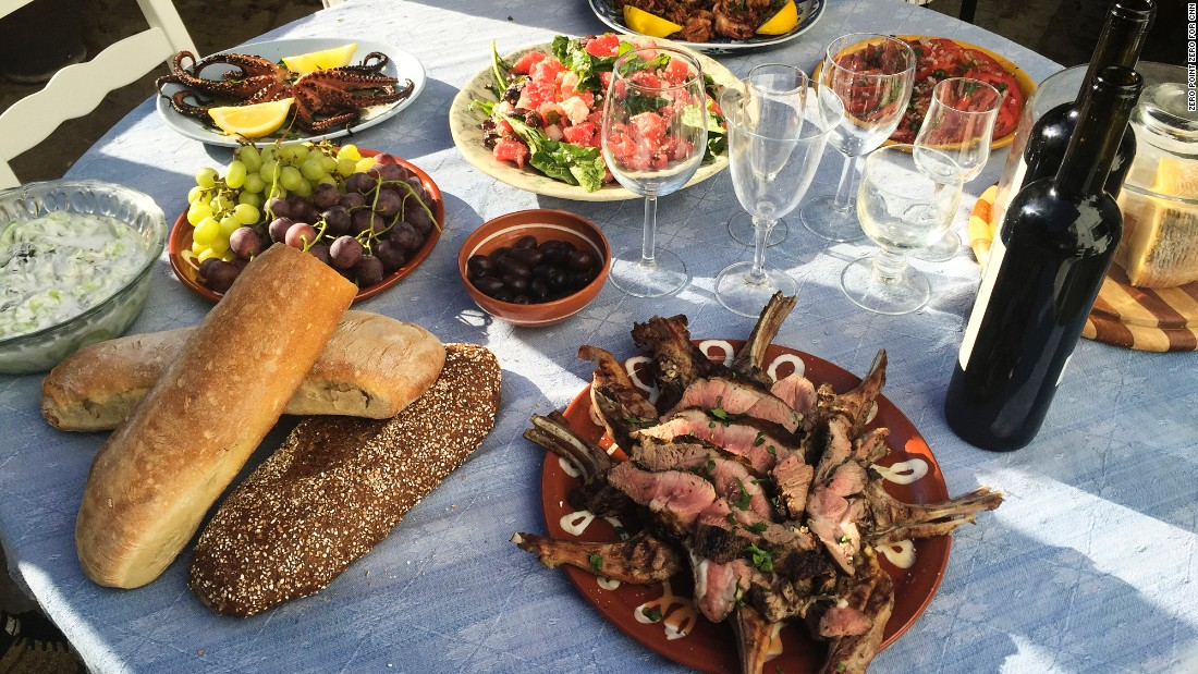 Bourdain speads out a feast -- lamb chops, octopus, calamari, local Naxian cheese, olives and salad -- at his rented villa.