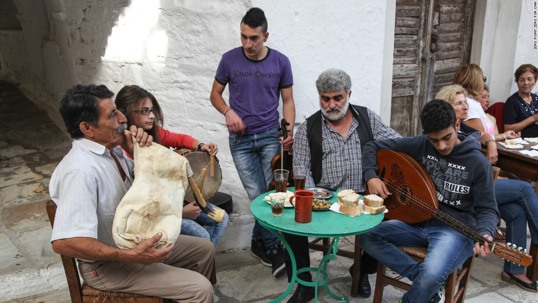 Local musicians in the village of Apeiranthos play traditional folk songs.