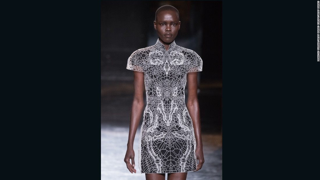 "One of the recurring themes of her ""Lucid"" collection -- part of an ongoing collaboration with architect Philip Beesley -- was laser-cutting. Here, the laser-cut pieces are connected with clear tubes to create the illusion of a wearable exoskeleton."