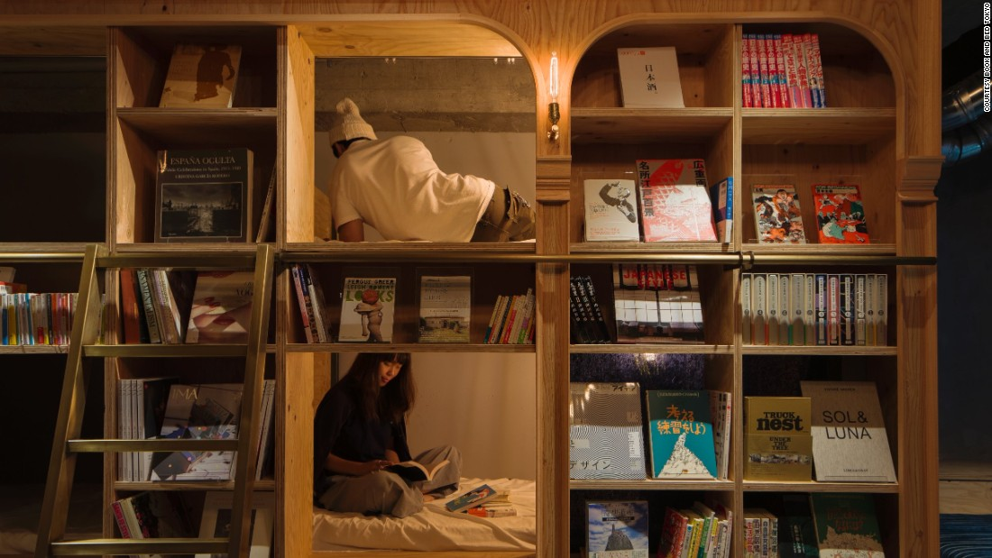 Opened in late 2015, the bulk of Book and Bed's beds sit inside a long wooden bookcase found in the main area of the hostel.