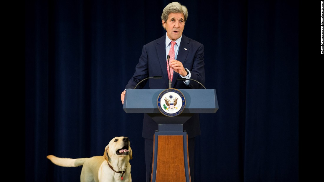 "U.S. Secretary of State John Kerry is accompanied by his dog Ben as he speaks to State Department workers on ""Take Your Kids to Work Day"" on Thursday, April 28."