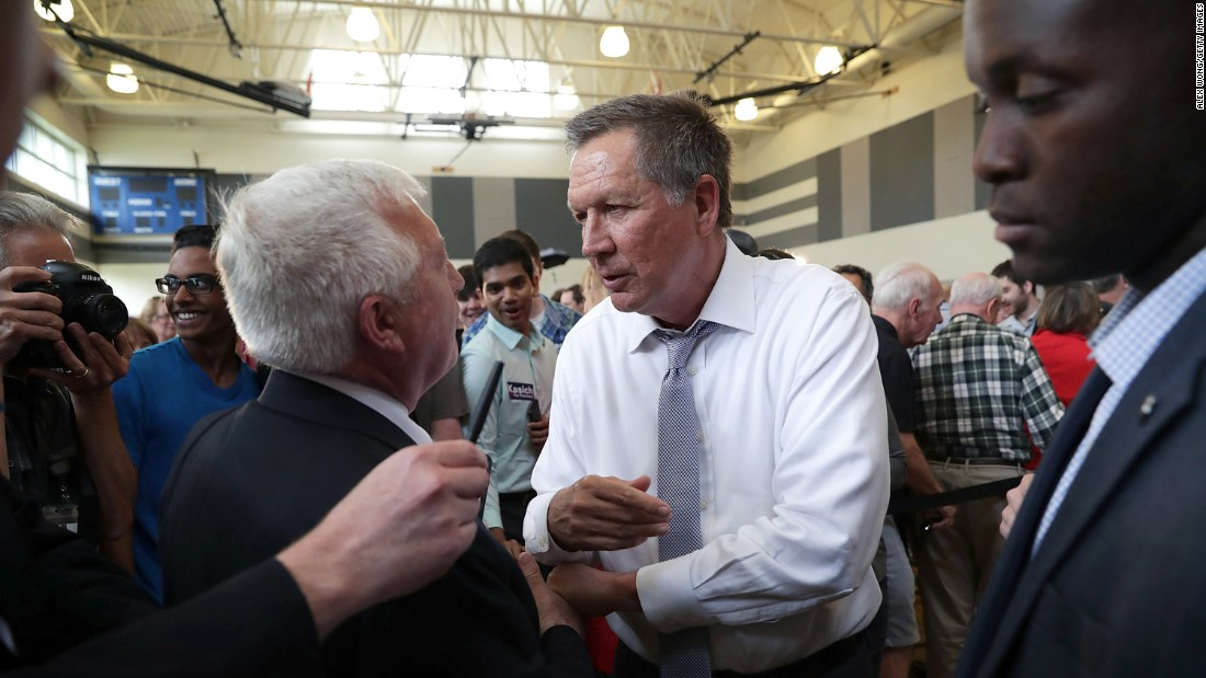Ohio Gov. John Kasich greets a voter during a presidential campaign event in Rockville, Maryland, on Monday, April 25.