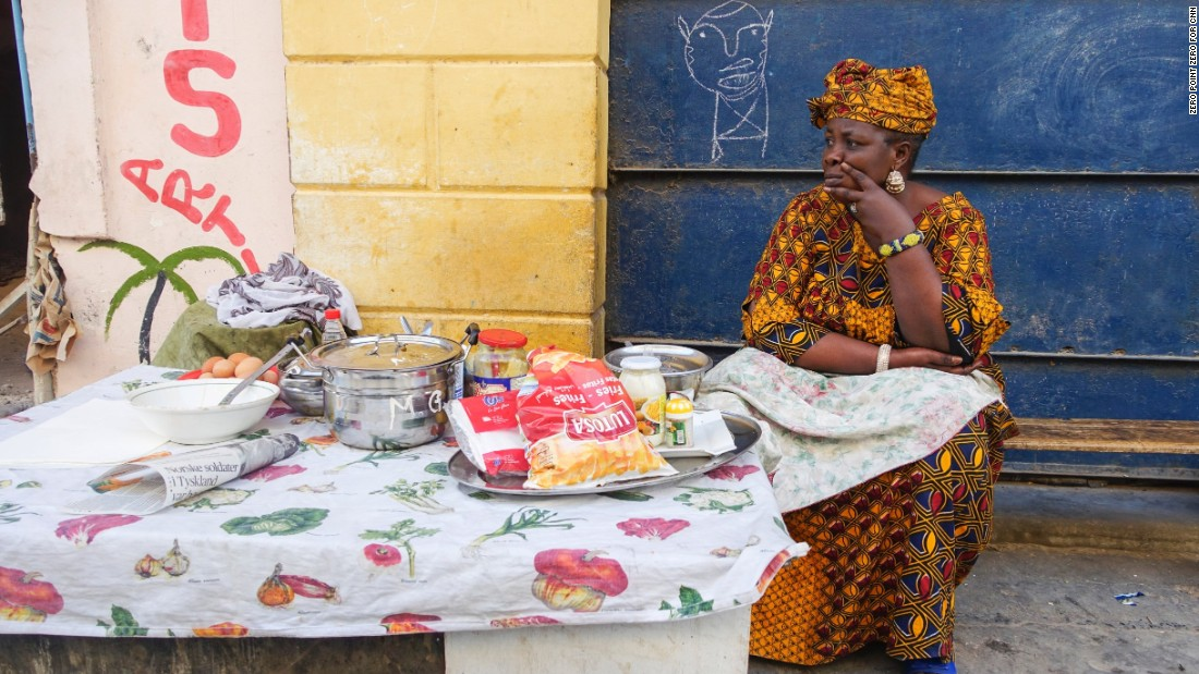 A breakfast vendor waits for customers in Saint-Louis.