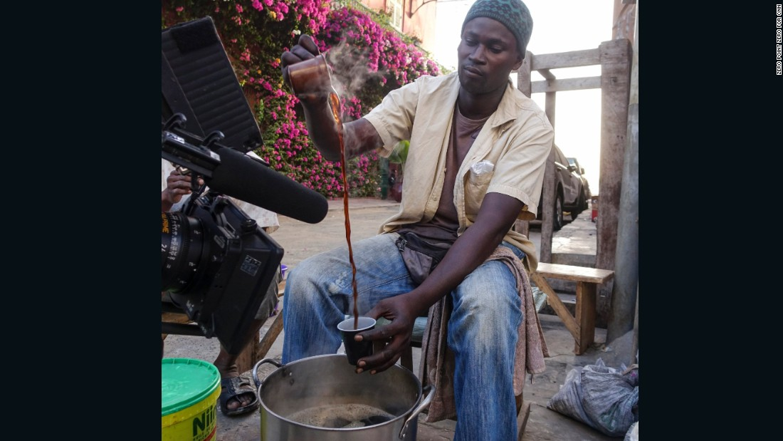 A vendor pours Cafe Touba --coffee made with djar, an African black pepper, and sugar -- in Saint-Louis.