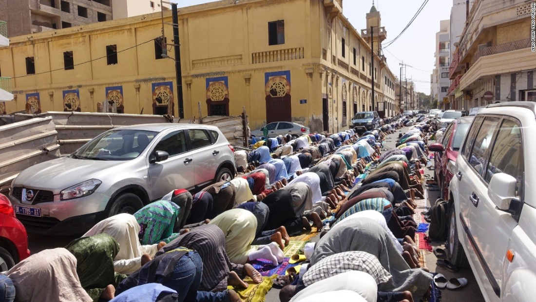 Senegal is 94% Muslim but is also home to 10 distinct ethnic groups. The overflow from the mosques spills into the streets during Friday prayers in Dakar.