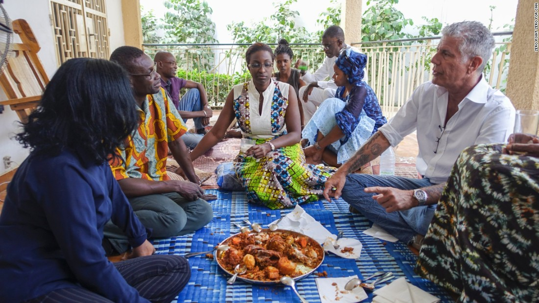 "Before leaving, Bourdain joins chef Pierre Thiam at his aunt's house with family and friends for a home-cooked meal of fish and rice served in a communal bowl. They teach him about the concept of ""teranga,"" which translates loosely as hospitality and includes a philanthropic outlook on life."