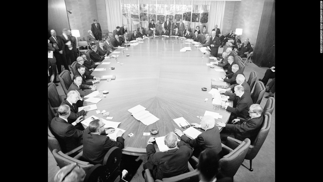 Negotiators sit at a table discussing the sale of the Empire State Building. The building is sold in 1951 for $34 million to a group led by Roger Stevens, but is also sold to Prudential Insurance Company of America, which agreed to a long-term lease.