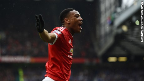 Anthony Martial of Manchester United celebrates after scoring the game's opening goal.