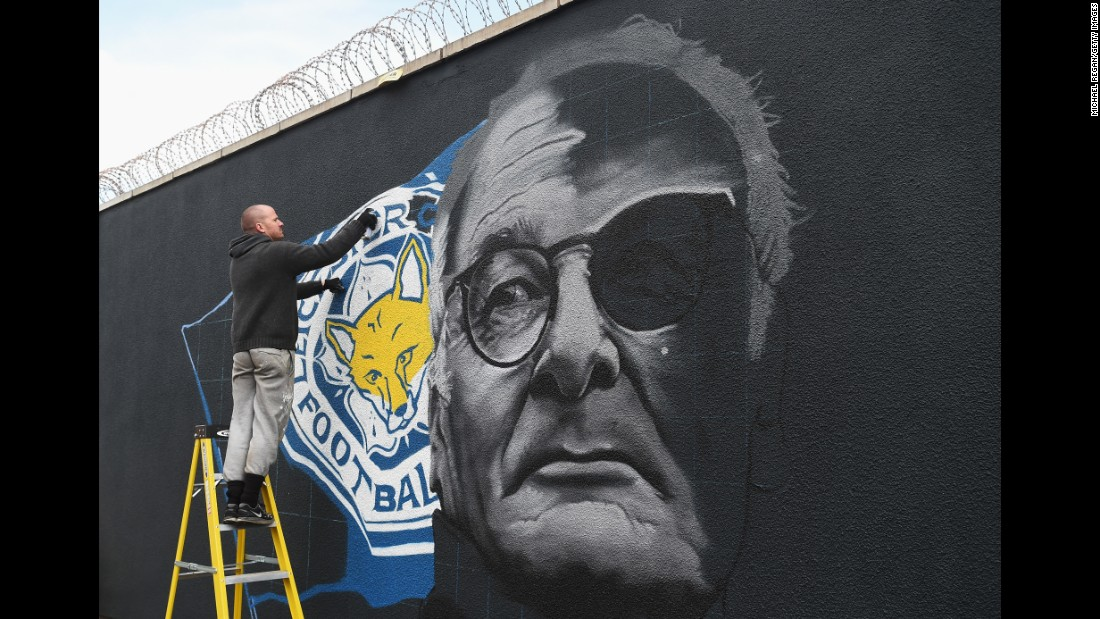 After the game Ranieri said he wouldn't be watching the game between Chelsea and Spurs. It was reported he would be on a plane flying from Italy to England after having taken out his 96-year-old mother for lunch. Here the Leicester manager is pictured in a painting on a wall.