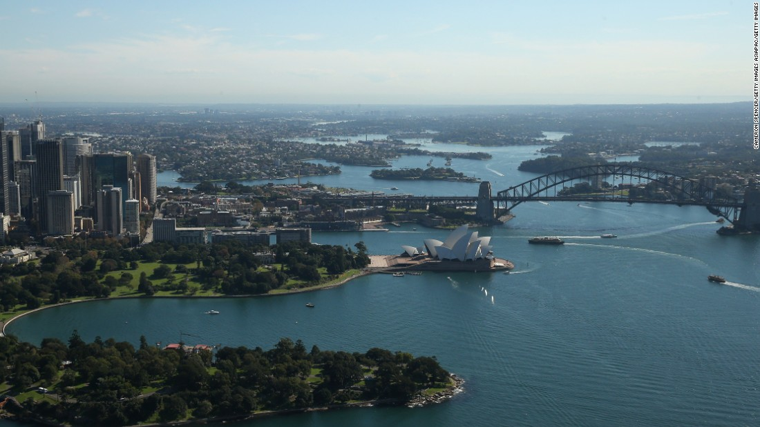 "The most familiar Sydney view of all: the Opera House and Sydney Harbor Bridge as photographed from the Appliances Online blimp, the only one currently flying in the Southern Hemisphere. It's the starting point of the <a href=""http://edition.cnn.com/videos/sports/2016/01/14/mainsail-rolex-sydney-hobart-spc-c.cnn"" target=""_blank"">Sydney to Hobart yacht race</a>, won in December by American yacht Comanche."