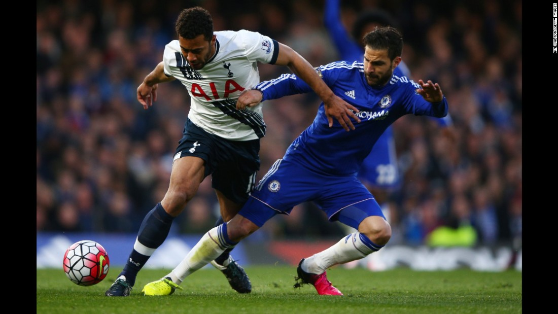 Tottenham's Mousa Dembele, left, is tackled by Chelsea's Cesc Fabregas during the match in London.