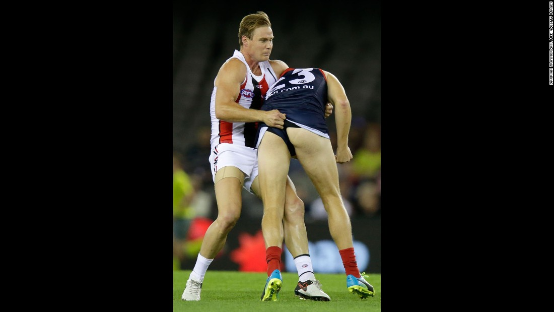 David Armitage of the St. Kilda Saints tackles Bernie Vince of the Melbourne Demons during an Australian Football League match in Melbourne on Saturday, April 30.