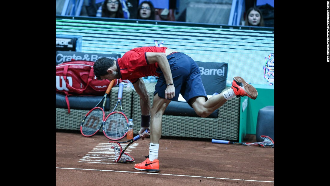 Grigor Dimitrov breaks his racket in frustration during the Istanbul Open final on Sunday, May 1. Dimitrov smashed three rackets during the match -- the last one cost him a game penalty and conceded the match to Diego Schwartzman.