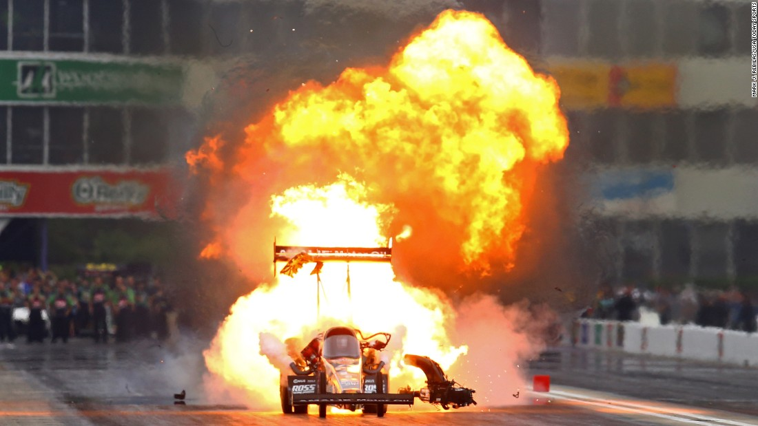 Fire billows from the car of Terry McMillen during a drag race in Baytown, Texas, on Sunday, May 1. It is not uncommon to see fire from dragsters as their engines are pushed to the limit.