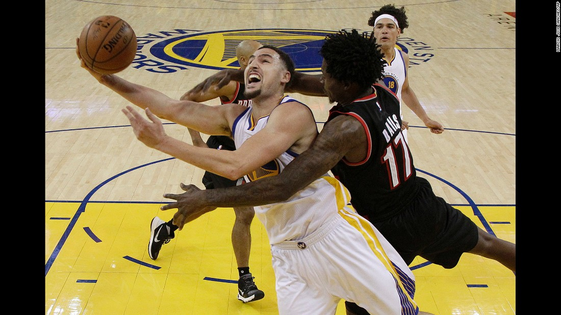 Golden State's Klay Thompson is fouled by Portland's Ed Davis as he scores in an NBA playoff game on Sunday, May 1. Thompson had 37 points for the Warriors, who won the first game of the second-round series 118-106.