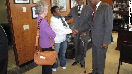 Thompson shakes hands with Florine Gatling, whose ex-husband, Paul, received an exoneration for his 1964 murder conviction on Monday.