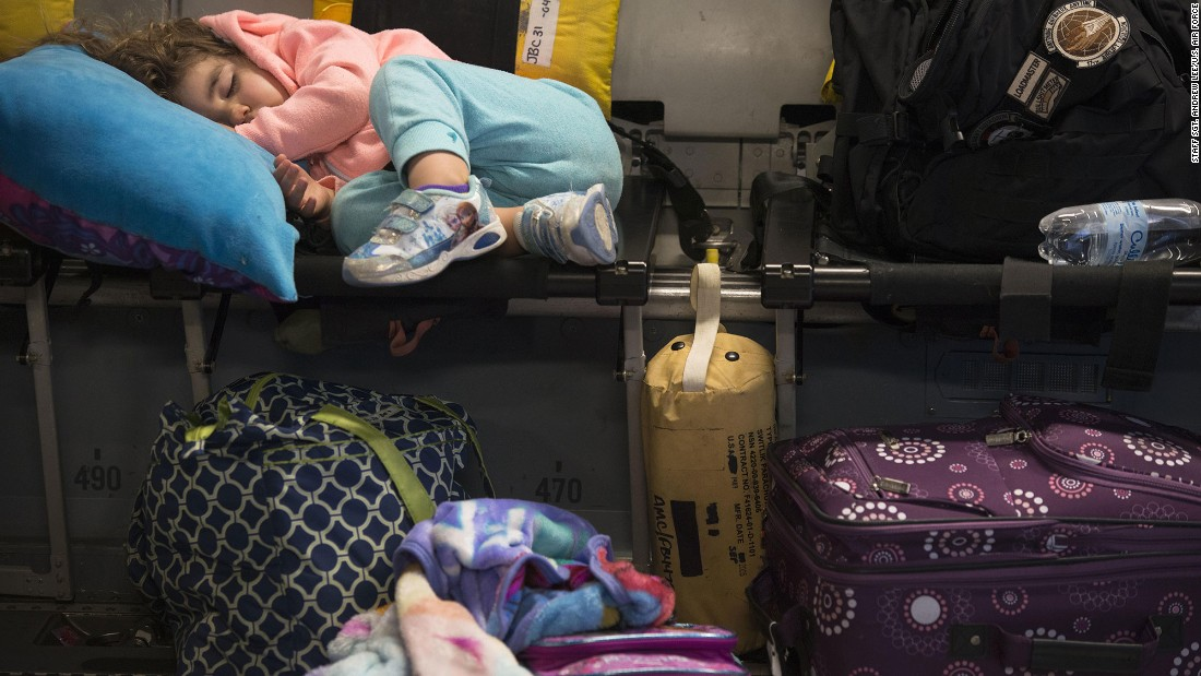 "Amelia McNab, 2, sleeps inside a military transport plane Friday, April 1, at Baltimore-Washington International Airport. The U.S. military <a href=""http://www.cnn.com/2016/03/29/politics/pentagon-orders-military-families-to-leave-southern-turkey/"" target=""_blank"">ordered military family members</a> to evacuate southern Turkey because of security concerns, the Pentagon said. A U.S. official said the evacuation was made because of the ongoing threats concerning possible ISIS attacks."