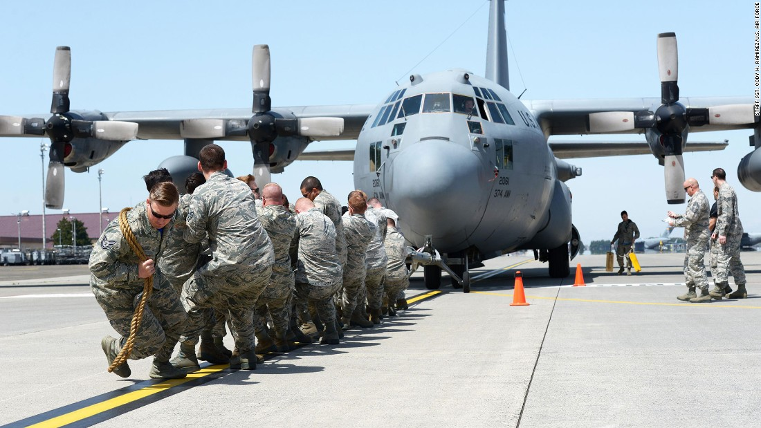 Members of the 374th Maintenance Squadron pull a C-130 Hercules at Yokota Air Base in Japan on Friday, April 15. It was part of a Maintenance Rodeo Competition that pits squadrons against one another.