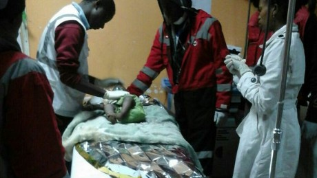 A baby girl receives treatment after being rescued from the rubble of a building in Nairobi.