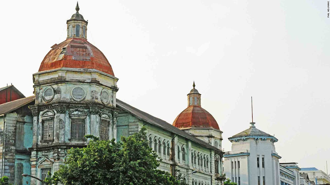 Originally built as the Currency Department, the Yangon Division Court building on Pansodan Street is one of the most fascinating buildings in the city. Damage sustained during a World War II bombing raid is still visible on its octagonal corner domes.