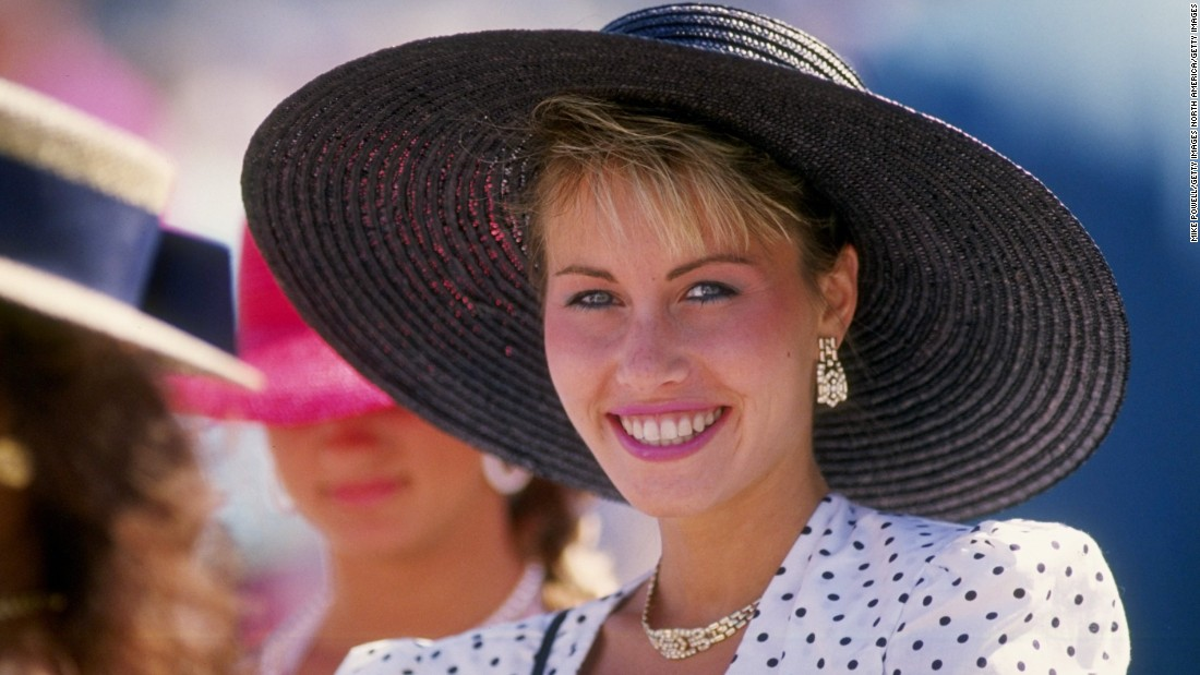 In the 1980s, the bigger the better. Big hat brims, big shoulder pads, and judging by this race-goer, a big smile.