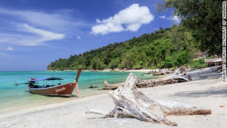 Ko Adang's beaches are reached by long-tail boat.
