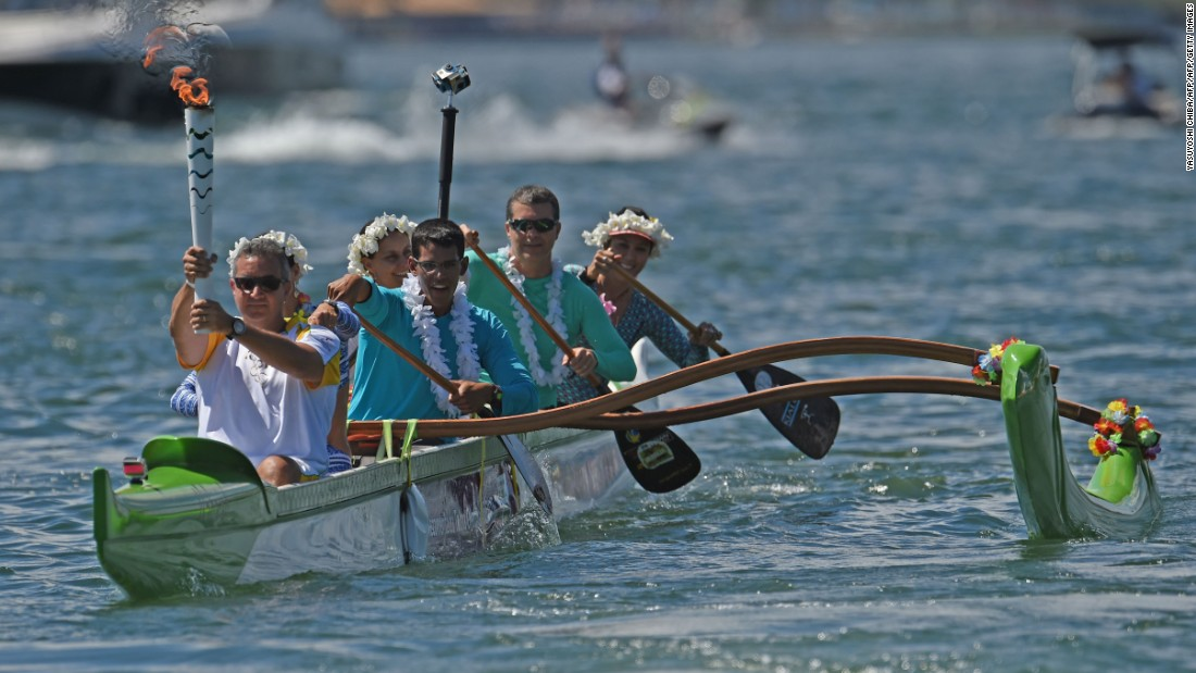 Canoeist Rubens Pompeu carried the Olympic flame on an outrigger canoe at Lake Paranoa. The torch will be carried in a relay by 12,000 people throughout its journey across the country.<br />