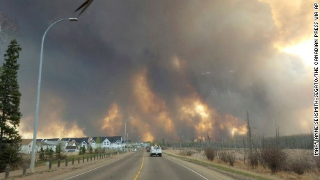 The entire population of Fort McMurray has been ordered to evacuate as a wildfire engulfed homes.