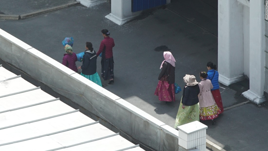 Women in scarves walk past the Koryo Hotel in central Pyongyang, North Korea, Wednesday, May 4.