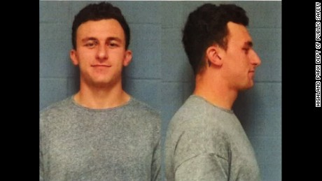 Heisman Trophy winner Johnny Manziel turned himself in to the Highland Park Police Wednesday afternoon on charges of domestic violence stemming from an incident at a Dallas hotel on Janaury 29, according to Lt. Lance Koppa with the Highland Park Dept of Public Safety.