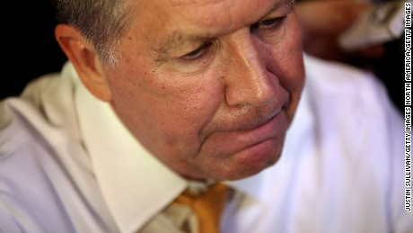 Former Republican presidential candidate John Kasich talks with reporters after having lunch at PJ Bernstein's Deli Restaurant on April 16, 2016 in New York City.