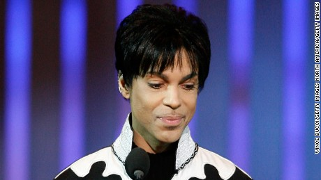 "LOS ANGELES, CA - MARCH 02:  Musician Prince accepts the award for ""Outstanding Male Artist"" onstage during the 38th annual NAACP Image Awards held at the Shrine Auditorium on March 2, 2007 in Los Angeles, California.  (Photo by Vince Bucci/Getty Images)"