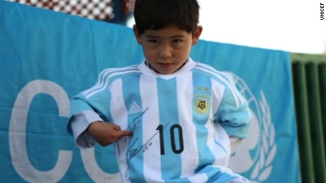 The five year old Afghan child whose image went viral after being photographed wearing a homemade jersey of argentine football star Lionel Messi, has been forced to leave Afghanistan.   Lynda Kinkade reports.