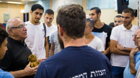 Holocaust survivor Solomon Moshe tells young Israelis about his experiences in the war, and shows his childhood teddy bear