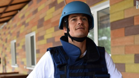 On 28 April 2016, UNICEF Goodwill Ambassador Orlando Bloom prepares to travel near the frontline of the conflict in eastern Ukraine.  He was required to know how to put on a flak jacket and helmet.UNICEF Goodwill Ambassador Orlando Bloom visits School #2 in Myronivskyi, just kilometres from the frontline in Eastern Ukraine.  The school's basement served as a bomb shelter for the community during heavy bombardment in January and February 2015.  The school originally had 800 pupils and now has 250, after people fled the area.Across the conflict area, approximately 580,000 children are in urgent need of aid and more than 230,000 children have been forced from their homes. Around one in five schools and kindergartens in the region have been damaged or destroyed and around 300,000 children are in immediate need of assistance to continue their education.  The trip came as new findings show that nearly a quarter of the world's school-aged children -- 462 million -- now live in countries affected by crisis.At the very first World Humanitarian Summit in Istanbul in less than three weeks' time, a  groundbreaking new fund  - the Education Crisis Platform - will be launched to get vital education to every child in need. It aims to raise nearly $4 billion to reach 13.6 million children in need of education in emergencies within 5 years, before reaching 75 million children by 2030.  In eastern Ukraine, and in emergencies across the world, UNICEF is working around the clock to get children back to learning -- to keep them safe and secure their futures. UNICEF so far has supported the repair and rehabilitation of 57 schools in eastern Ukraine and has supplied hundreds of thousands of children on all sides of the conflict with vital supplies like schoolbooks, desks and pencils, as well as psychological support and catch-up classes.  UNICEF has also reached nearly 280,000 children with information on the risks posed by land mines and unexploded ordnance, which litter