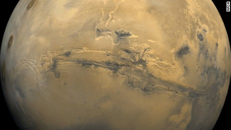Valles Marineris, or Mariner Valley, cuts across Mars in this mosaic of 102 images taken by NASA's Viking 1 orbiter in 1980. The valley is over 1864 milles (3,000 km) long and about 5 miles (8 km) deep.