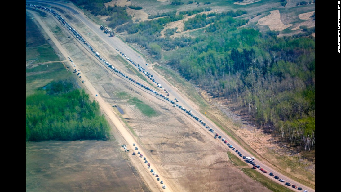 Traffic is at a standstill on Highway 63 south as residents flee the wildfire on May 4.