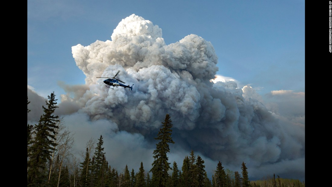 A helicopter flies past the wildfire in Fort McMurray on May 4.