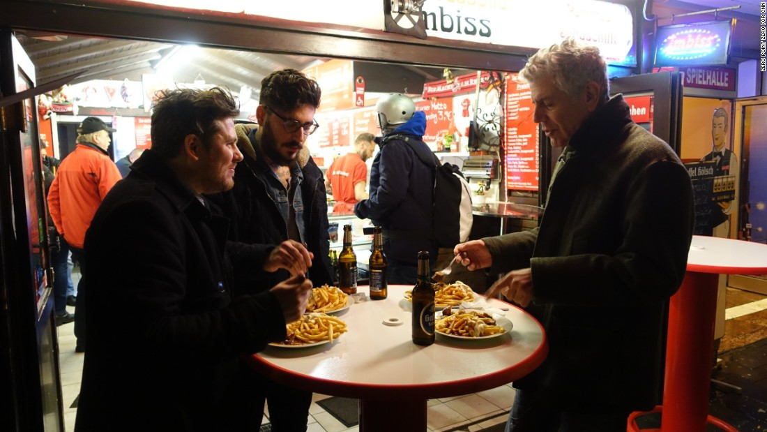 Ox & Klee chef Daniel Gottschlich, left, and friend Dimi Katsavaris meet Bourdain for some authentic German street food including currywurst and Spiessbraten.