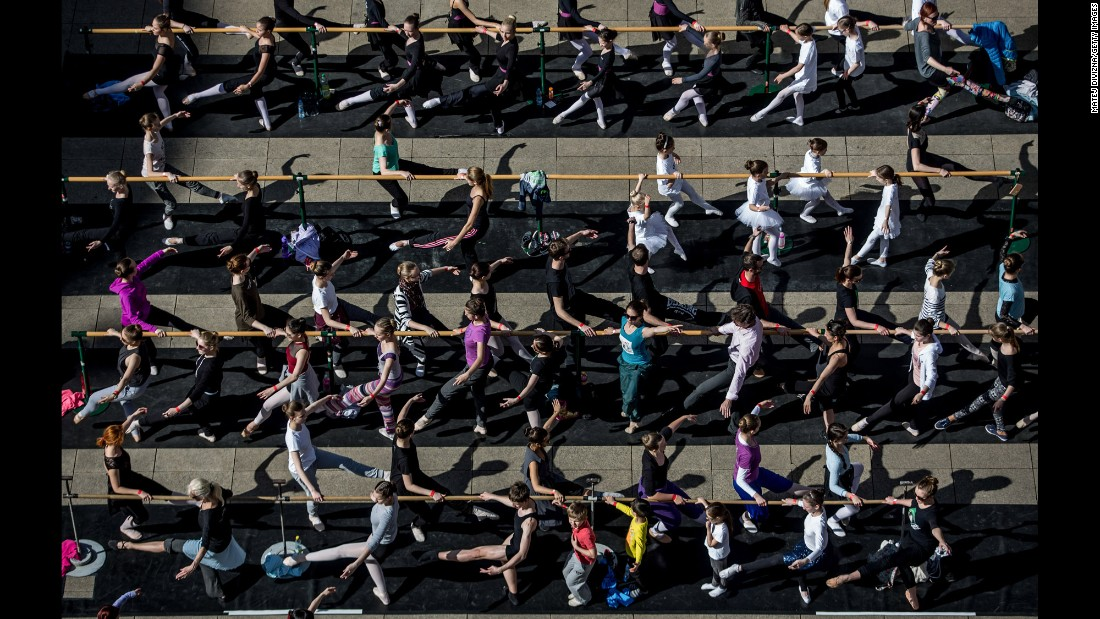 People take part in a ballet class in front of the National Theatre in Prague, Czech Republic, on Friday, April 29. It was International Dance Day.