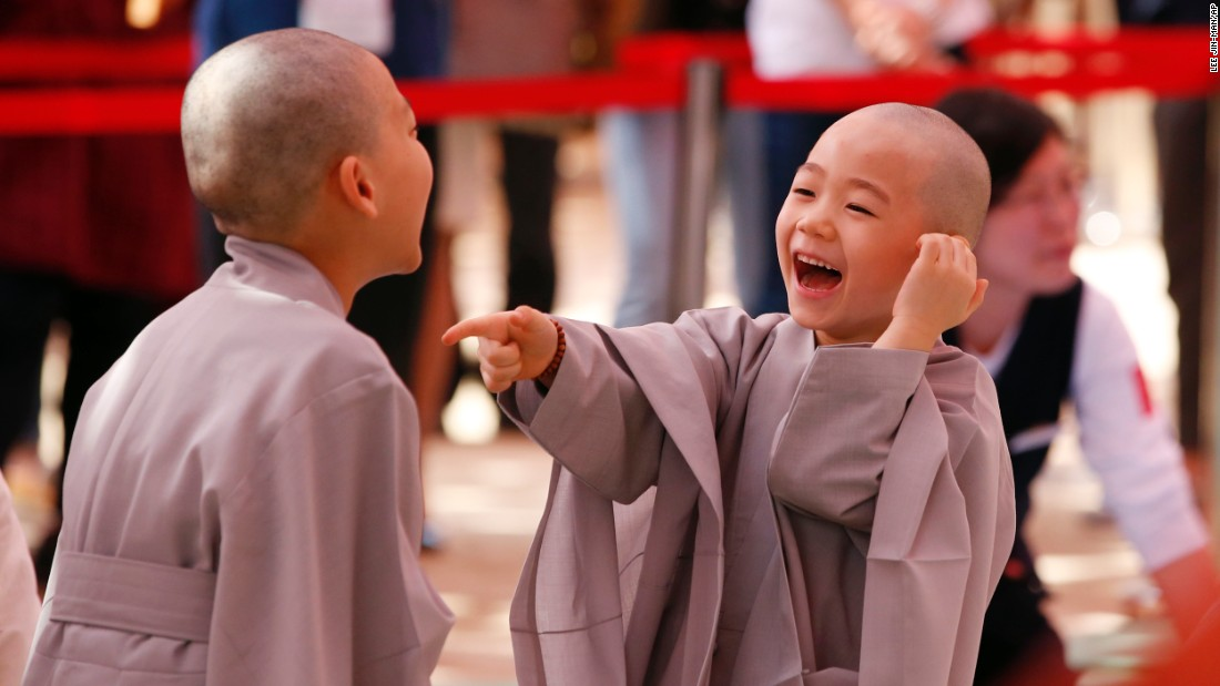 Two boys smile after they had their heads shaved at a Buddhist temple in Seoul, South Korea, on Monday, May 2. To commemorate Buddha's upcoming birthday, 10 children entered the temple to experience a monk's life for two weeks.