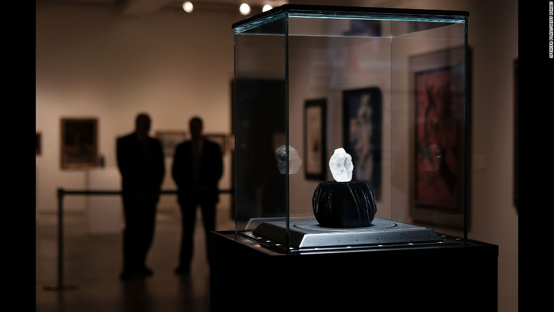 "Guards in New York stand next to the Lesedi la Rona, <a href=""http://money.cnn.com/2016/05/04/luxury/diamond-lucara-auction-70-million/"" target=""_blank"">a diamond the size of a tennis ball</a> that will be auctioned next month in London. The diamond was found in Botswana in November. It took months to determine an estimated price because it does not fit into conventional scanners. Sotheby's said the diamond is 1,109 carats, which makes it the largest rough, gem-quality diamond in existence today. It is believed to be between 2.5 billion and 3 billion years old."