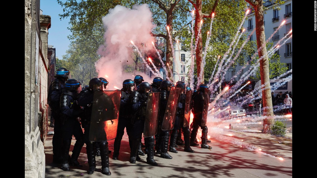 Clashes erupt between police and protesters during a May Day rally in Paris on Sunday, May 1. Violence broke out as people protested a proposed labor bill.