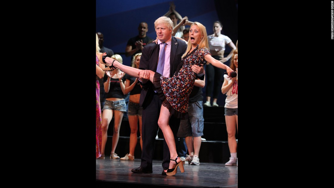 Johnson holds dance champion Camilla Dallerup at an event in London on July 1, 2010.
