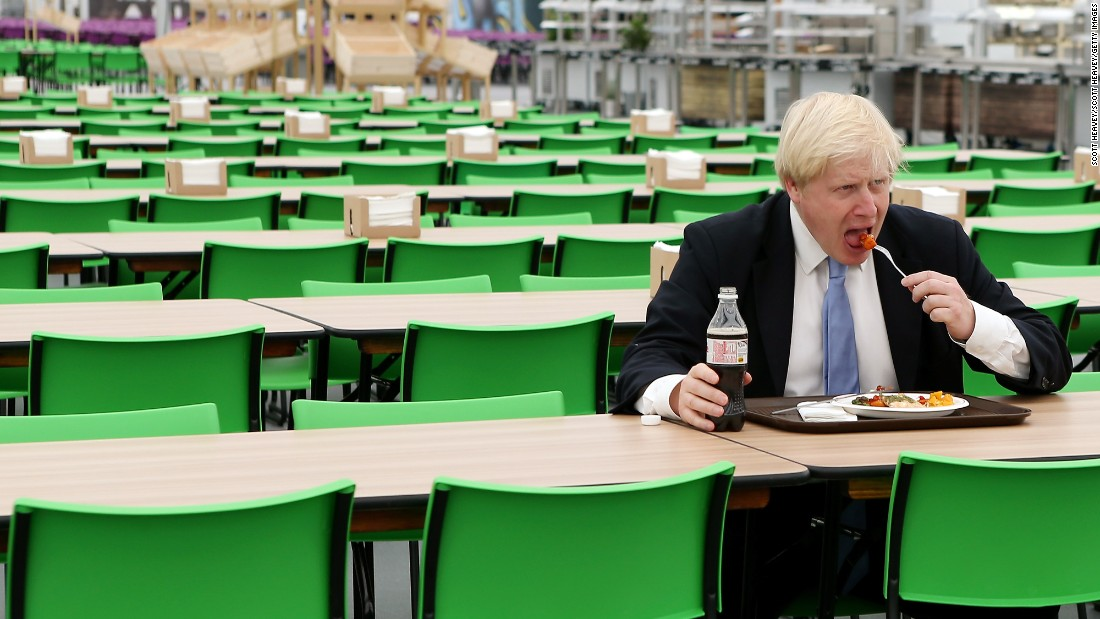 Johnson eats in the Olympic Village in London on July 12, 2012.