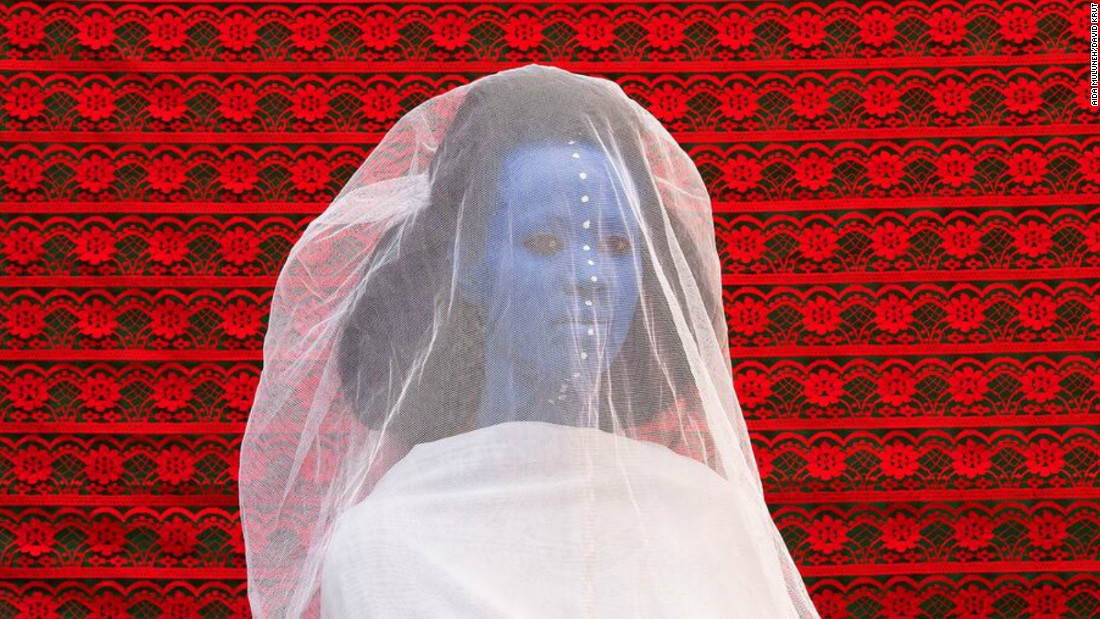 "<br />Aida Muluneh, The Morning Bride (2016). The image is part of the Ethiopian's The World is 9 series looking at life, love, history, and whether we can live in this world with full contentment. ""I am not seeking answers but asking provocative questions about the life that we live -- as people, as nations, as beings,"" she says."