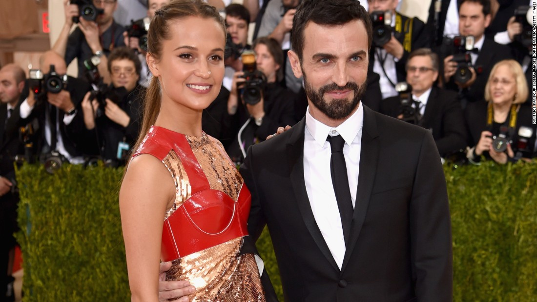Nicolas Ghesquire with actress and Louis Vuitton spokesperson Alicia Vikander --wearing Louis Vuitton -- at the 2016 Met Gala.