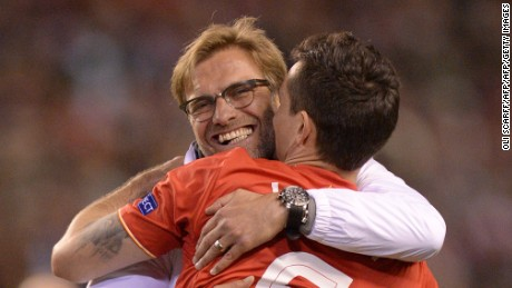 Kurgen Klopp embraces Dejan Lovren after the  3-0 victory over Villarreal.