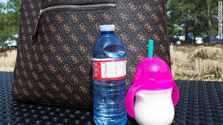 Cara Kennedy says she fled town only with her purse, some key documents and food and water for her baby.