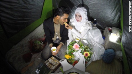A young Syrian couple tied the knot at Idomeni refugee camp in Greece this week. Courtesy Chris Morrow/CNN iReport.